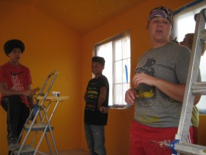 Kids paint interior of new community space.